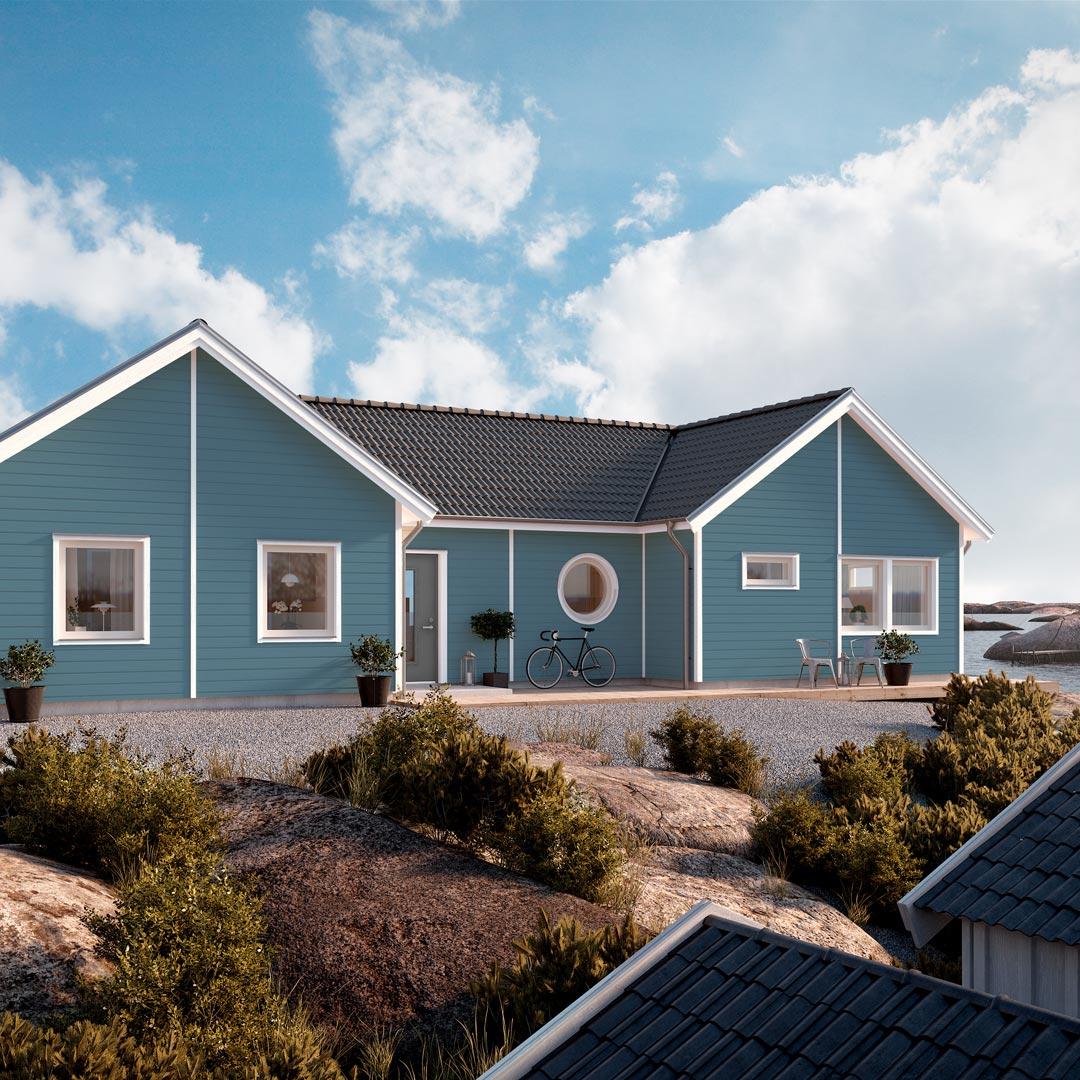 Hus ved sjøen malt med blåfarge salvie